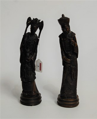 Lot 6-A pair of Asian resin figures, in the form of a...