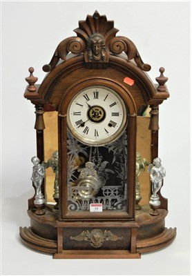 Lot 18-A late 19th century walnut cased mantel clock,...