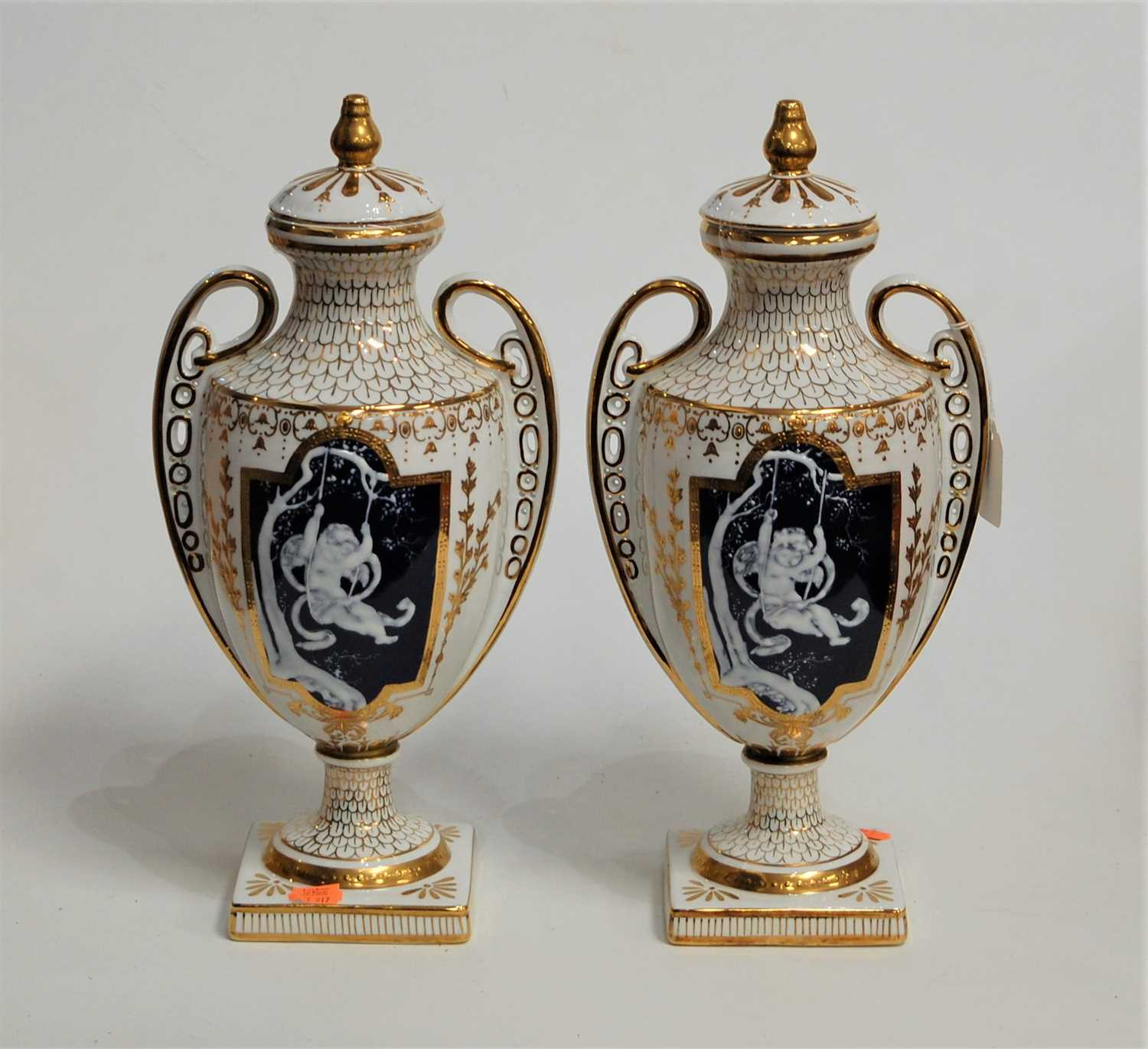 Lot 24-A pair of modern twin handled vases and covers,...
