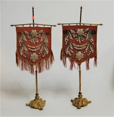 Lot 25-A pair of 19th century gilt brass table screens,...