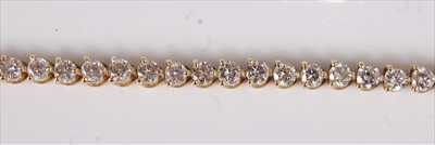 Lot 2207 - An 18ct yellow gold diamond tennis bracelet,...