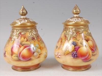 Lot 2042-A pair of Royal Worcester porcelain pot pourri...