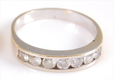 Lot 2027-A yellow metal diamond seven stone half hoop...