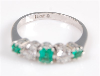 Lot 2002-A white metal, emerald and diamond five stone...