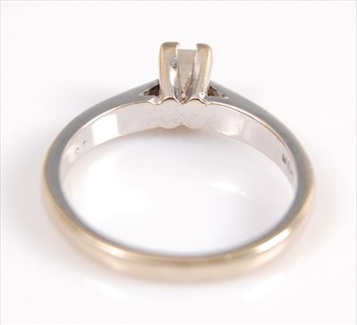Lot 2003-An 18ct white gold single stone diamond ring,...