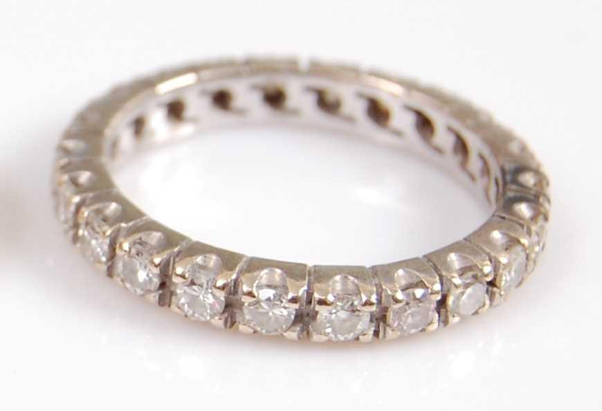 Lot 2004-A white metal diamond full hoop eternity ring,...