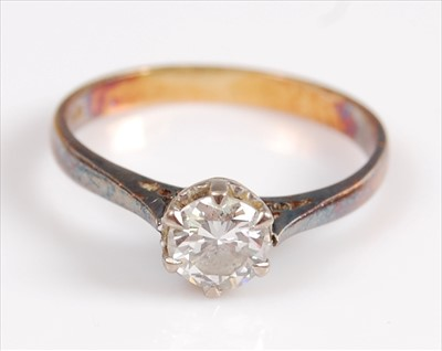 Lot 2036-A yellow and white metal single stone diamond...