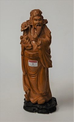 Lot 3-An Oriental hardwood carving of a scholar, on...