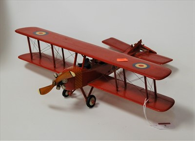 Lot 5-A painted softwood model of a biplane, with RAF...