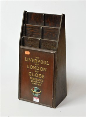 Lot 10-A wooden letter rack for the Liverpool & London...