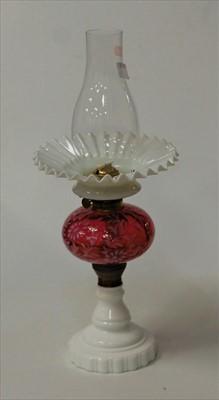 Lot 13-An opaline glass pedestal oil lamp, having...