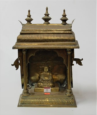 Lot 14-An Eastern brass pagoda with inset deity, h.42cm