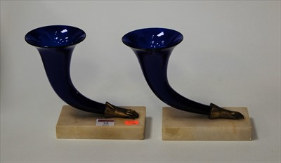 Lot 25-A pair of blue glass cornucopia vases, on marble...