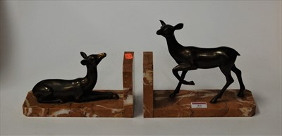 Lot 26-A pair of Art Deco book-ends, each modelled as...