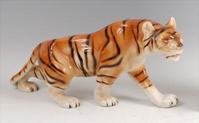 Lot 23-Royal Dux - a large porcelain model of a Tiger,...