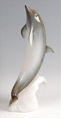 Lot 24-Royal Dux - a large porcelain model of a Dolphin, ...