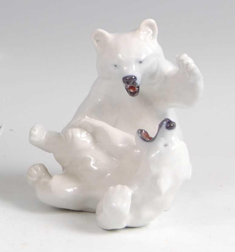 Lot 27-Royal Copenhagen - a glazed porcelain figure...