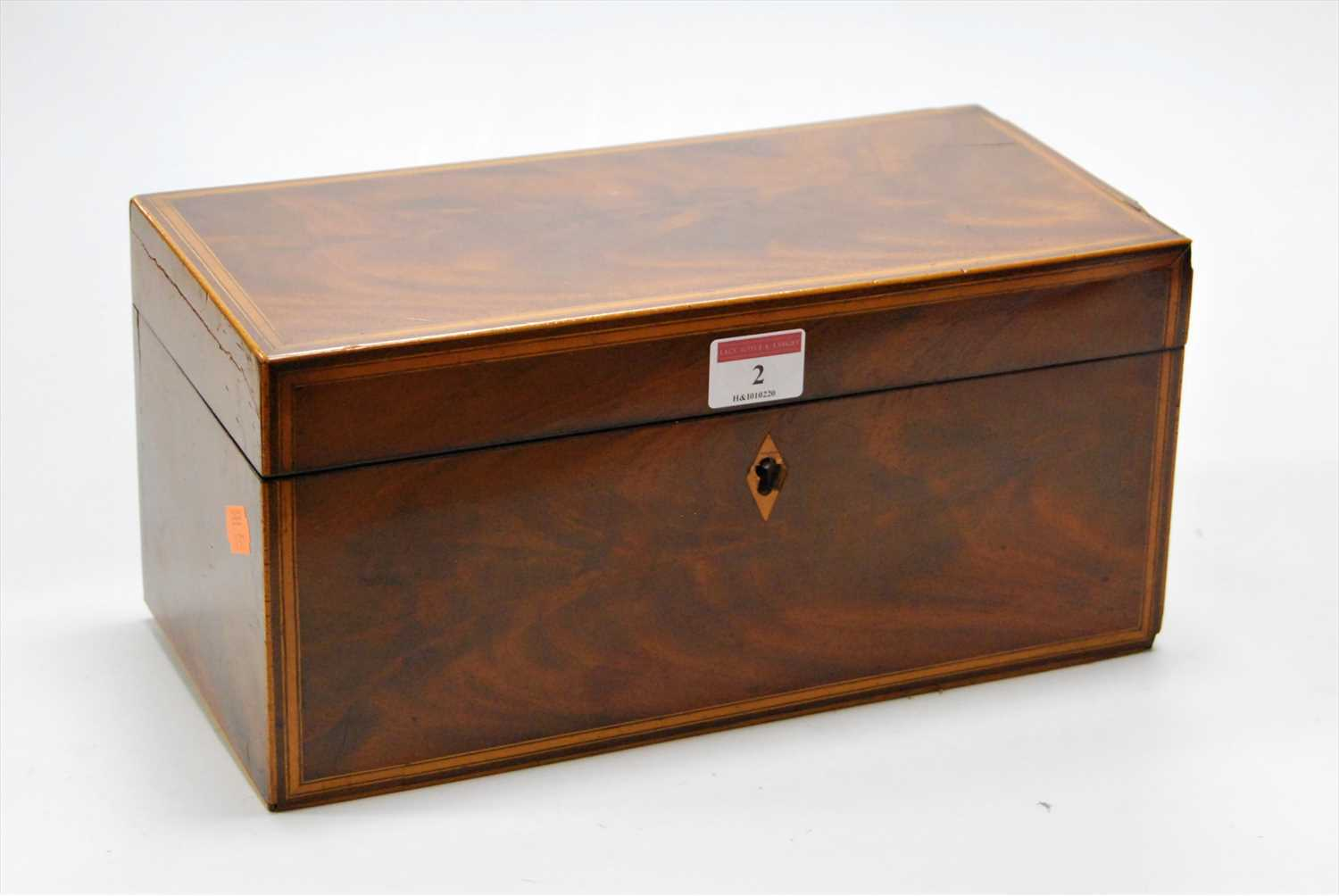 Lot 2-A George III mahogany and satinwood banded tea...