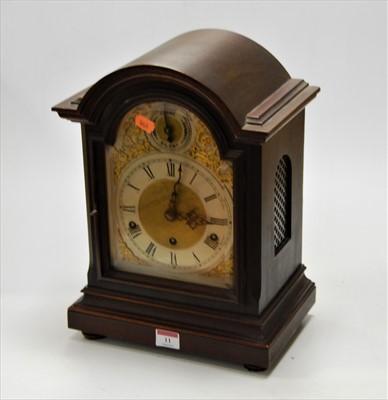 Lot 11-A mahogany cased bracket clock, the silvered...
