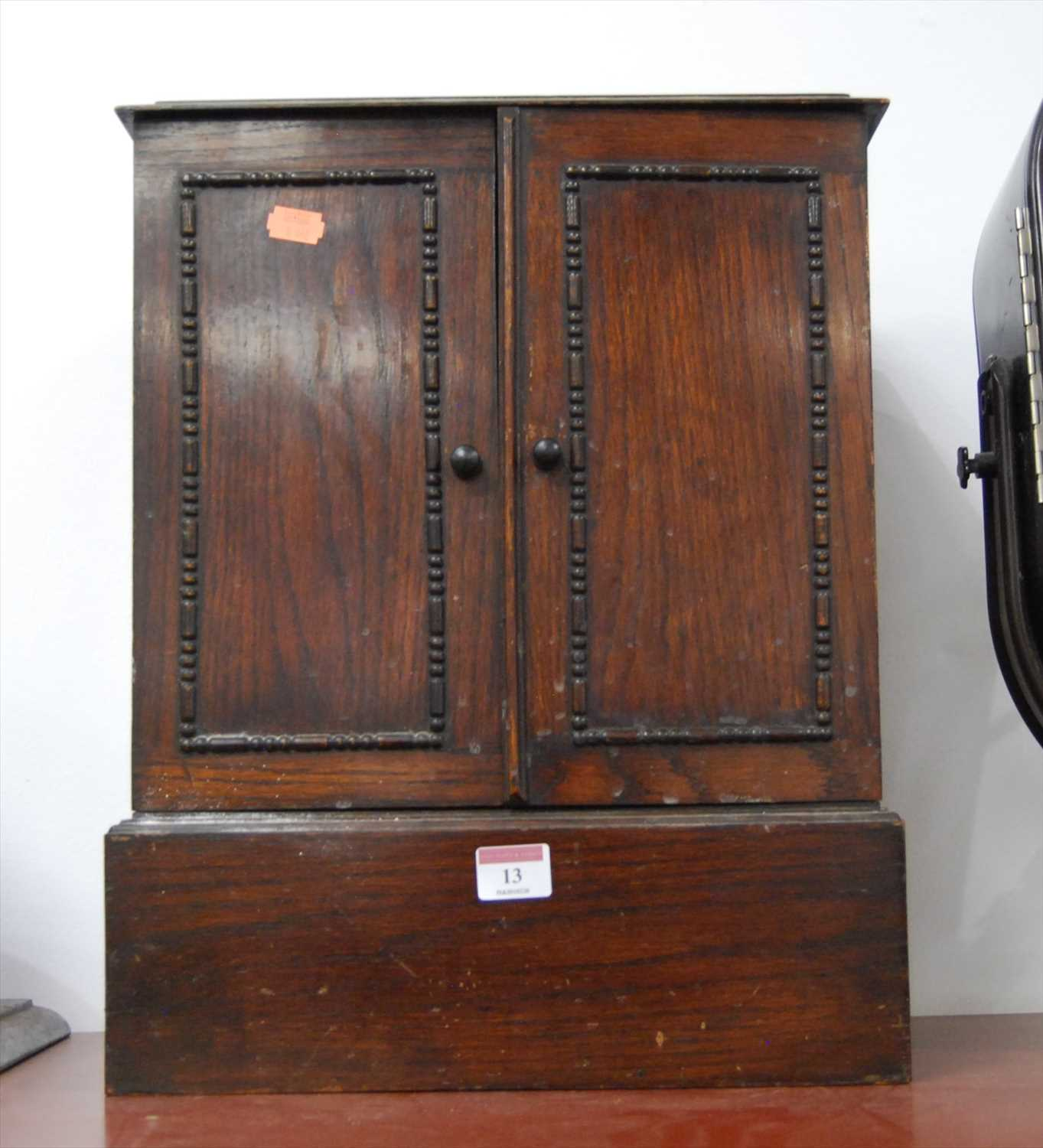Lot 13-A 1930s oak table cabinet, enclosed by a pair...