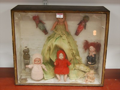 Lot 34-A collection of plastic and other dolls mounted...