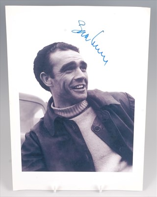 Lot 516-A collection of signed photographs and ephemera to include