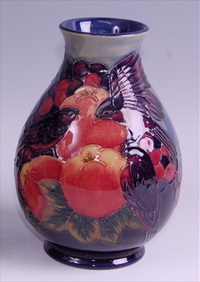 Lot 12-A modern Moorcroft pottery vase in the Finches...