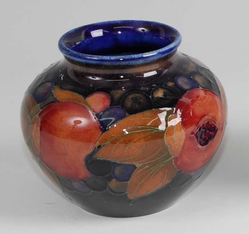 Lot 15-A Moorcroft pottery miniature shouldered squat...