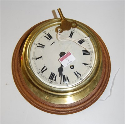 Lot 2-A brass cased ships clock, having an enamelled...