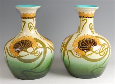 Lot 43 - A pair of large Art Nouveau pottery vases, in...