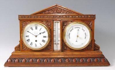 Lot 21 - A Victorian carved oak desk weather station,...