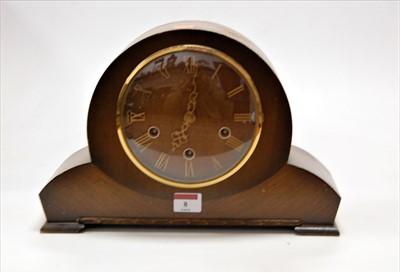 Lot 8-A 1950s oak cased mantel clock having raised...