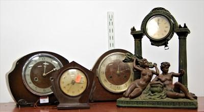 Lot 14-An Art Deco bakelite cased electric mantel clock, ...