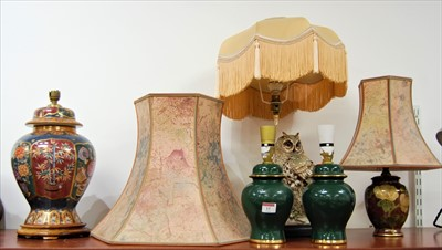 Lot 15-A modern table lamp surmounted by a resin figure...
