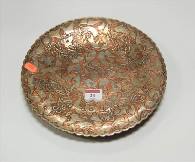 Lot 24-An early 20th century eastern copper dish of...