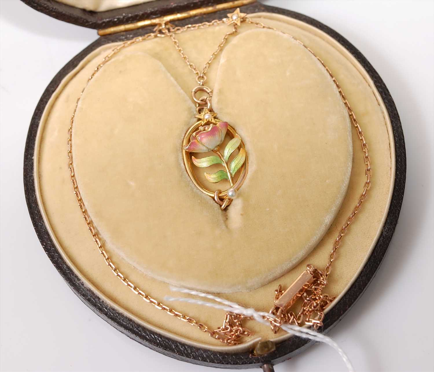 Lot 2209 - A rose and yellow metal oval pendant,...