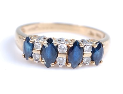 Lot 2005-An 18ct yellow and white gold, sapphire and...