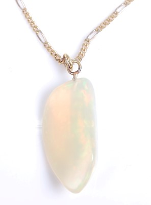 Lot 2043-An abstract polished opal pendant, dimensions...