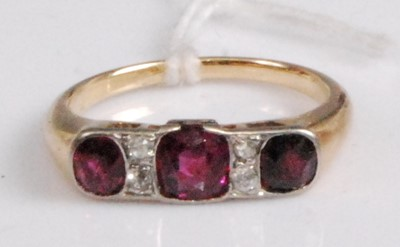 Lot 2046-A yellow metal, ruby and diamond ring, arranged...