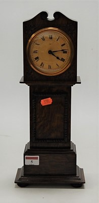 Lot 5-A miniature moulded oak longcase clock, having...
