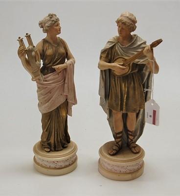 Lot 9 - A pair of Royal Dux type porcelain musician...