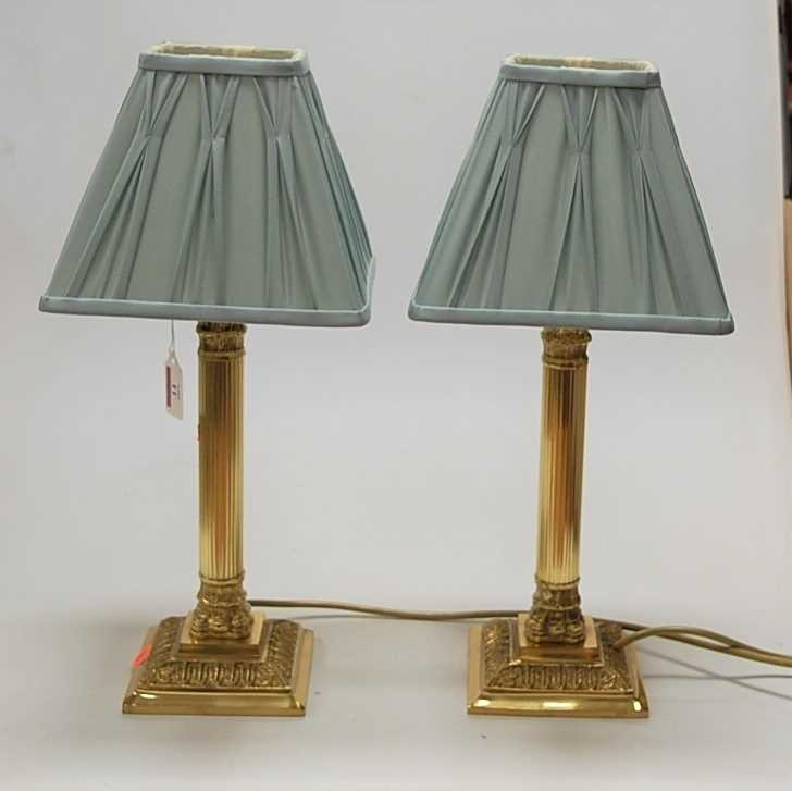 Lot 11-A pair of reproduction lacquered brass bedside...