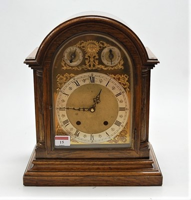 Lot 15 - An early 20th century oak cased dome topped...