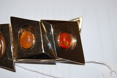 Lot 118 - A 1970s 14ct gold and fire-opal set bracelet,...