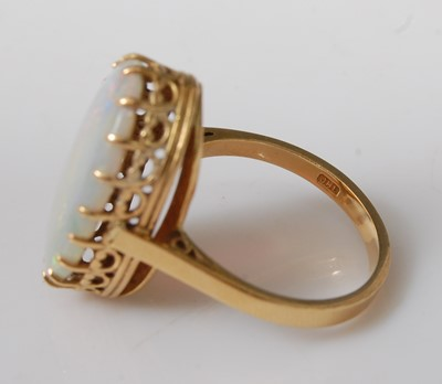 Lot 2503-An 18ct yellow gold oval opal dress ring, the...