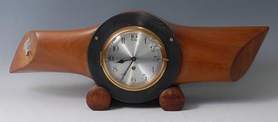 Lot 6-An early 20th century propeller mantel clock