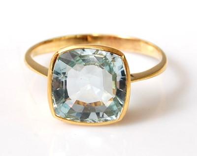 Lot 2505 - A yellow metal aquamarine single stone ring,...