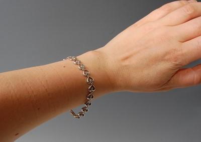 Lot 2506-A 9ct white gold diamond line bracelet,...