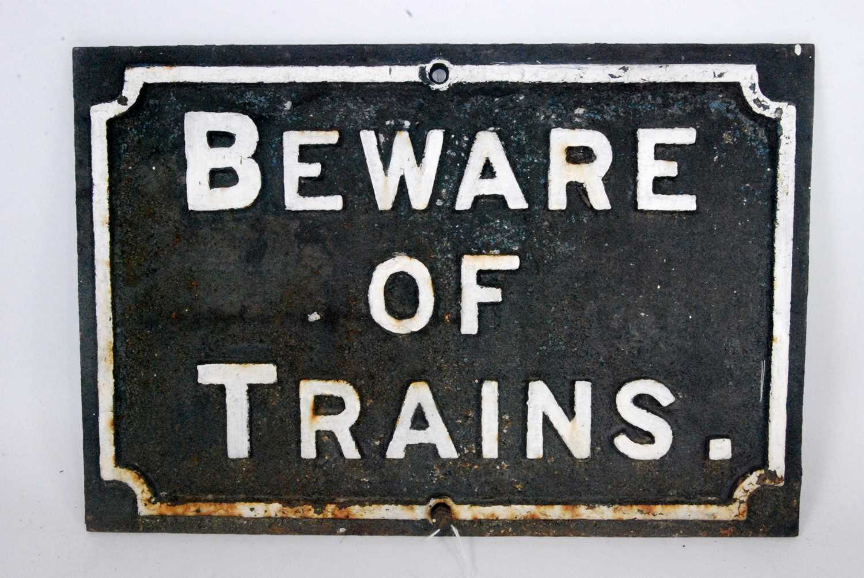 Lot 9-A original cast iron 'Beware of Trains' sign,...