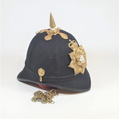 Lot 3-A blue cloth covered helmet, having a brass spike ...